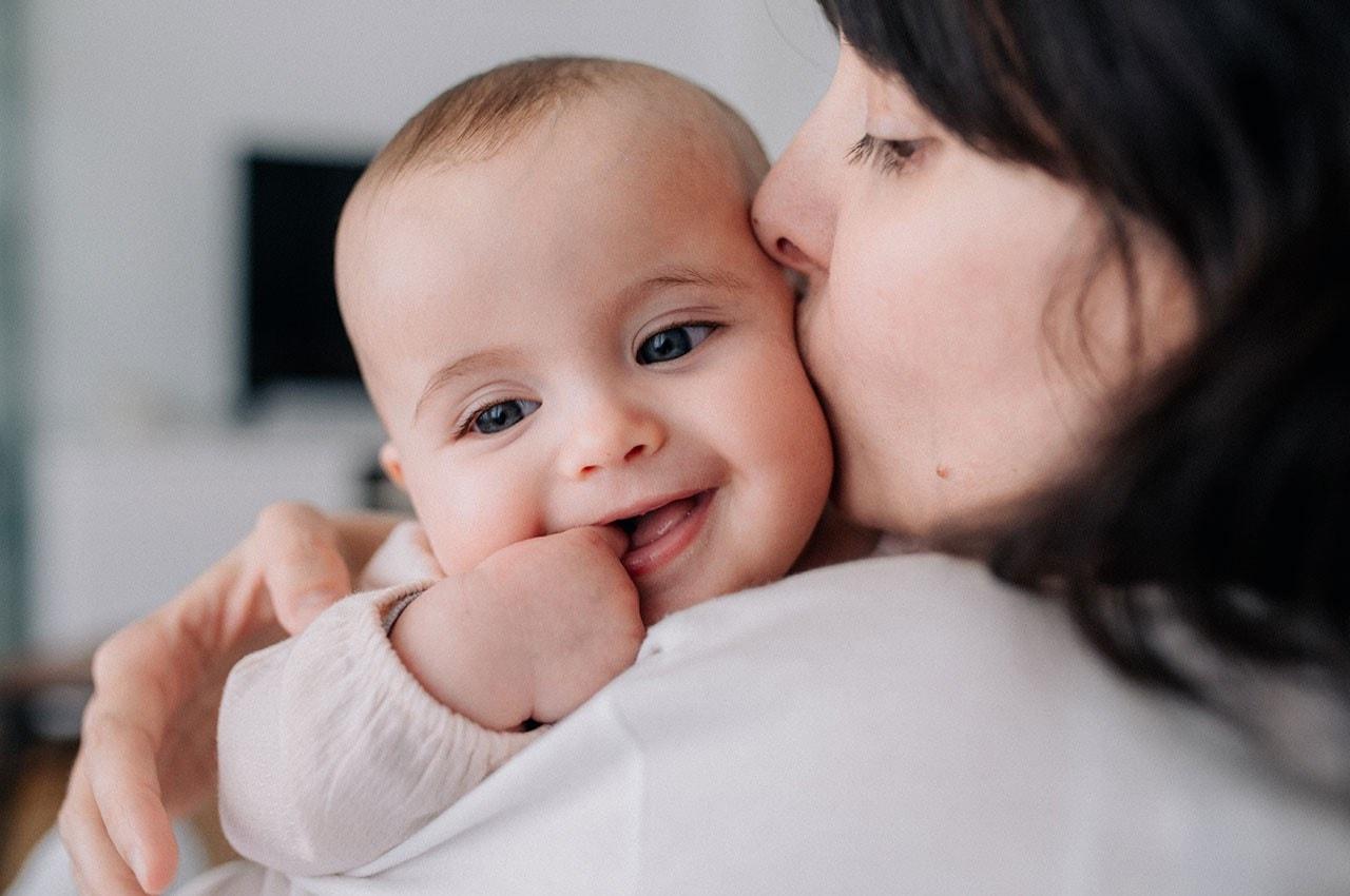 Smiling baby on a shoulder