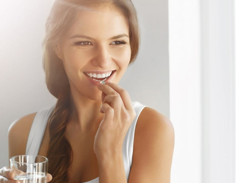 Woman taking a probiotic