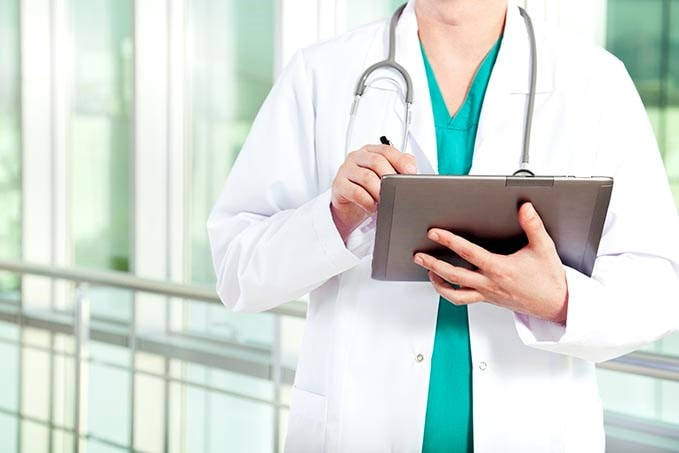 Doctor entering data on a tablet