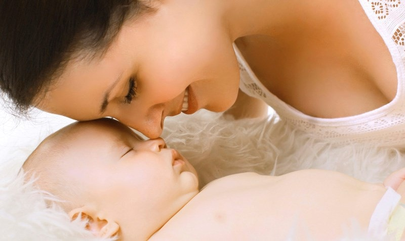 mother and baby touching noses