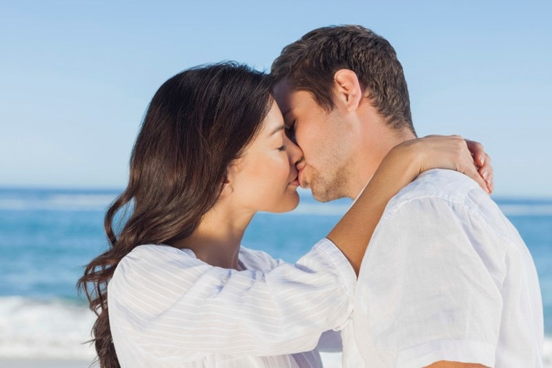male and female couple kissing