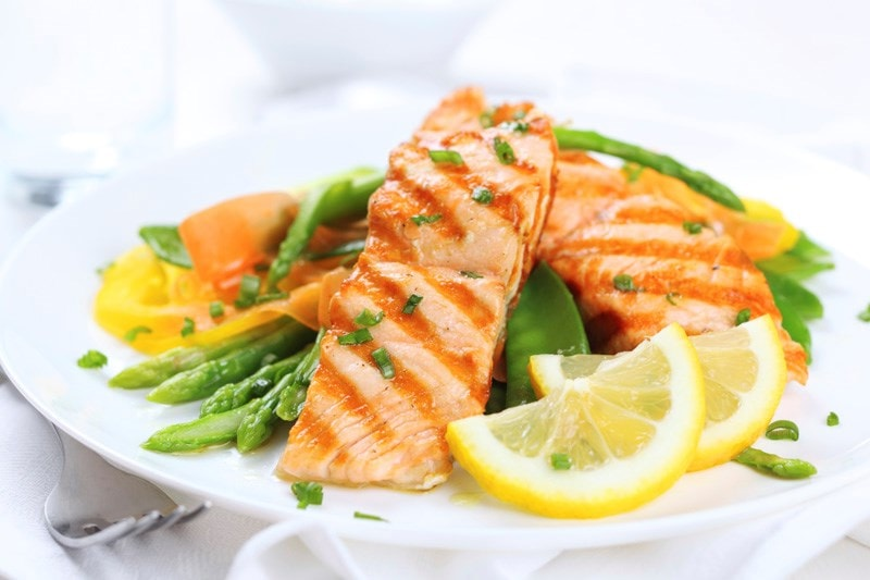 Salmon and vegetables on plate
