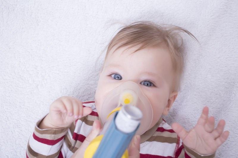 baby taking inhaler