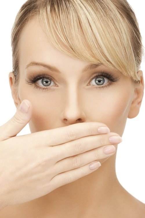 women covering mouth with hand