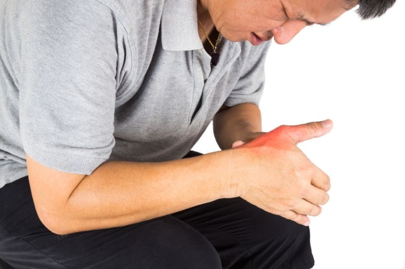 Man with pain in wrist