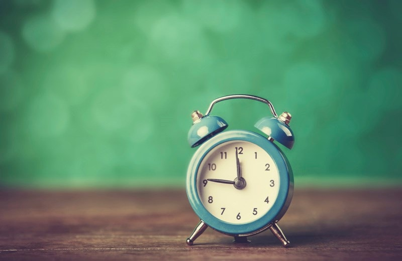 Small blue alarm clock