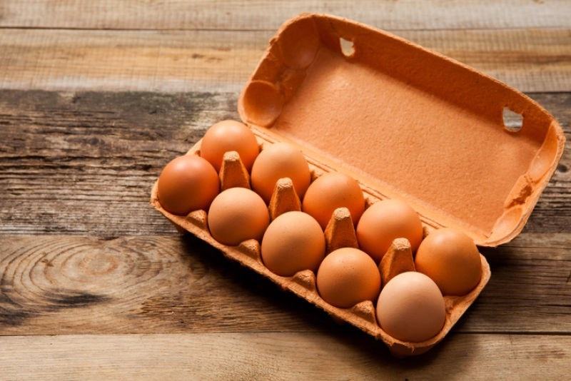 Open carton of a dozen eggs