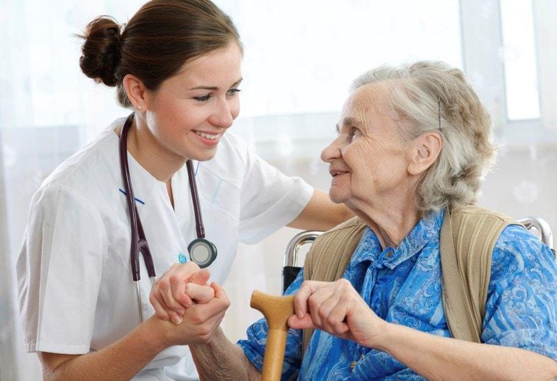 doctor holding elderly patients hand