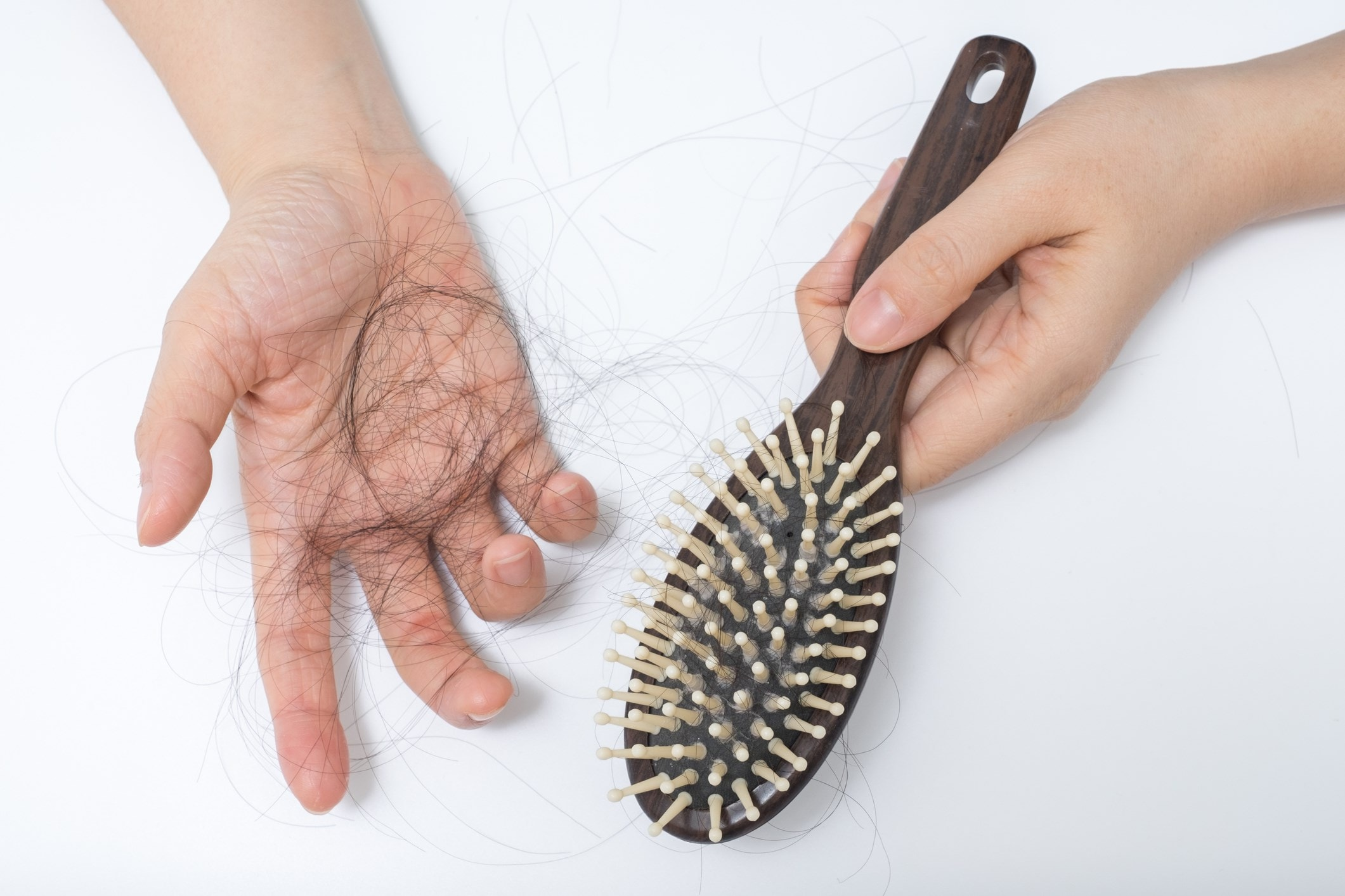 hand holding strands of hair