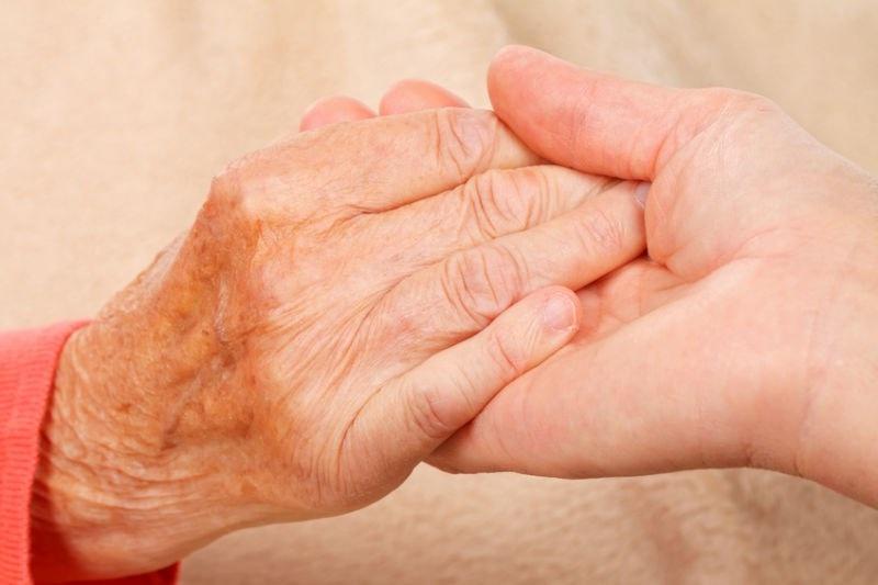 Mature hands holding hands