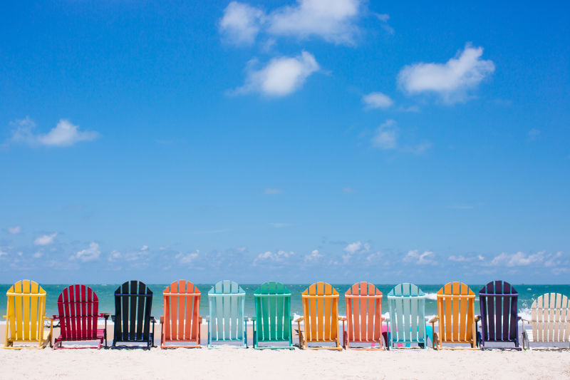 Beach scene with multi-coloured chairs