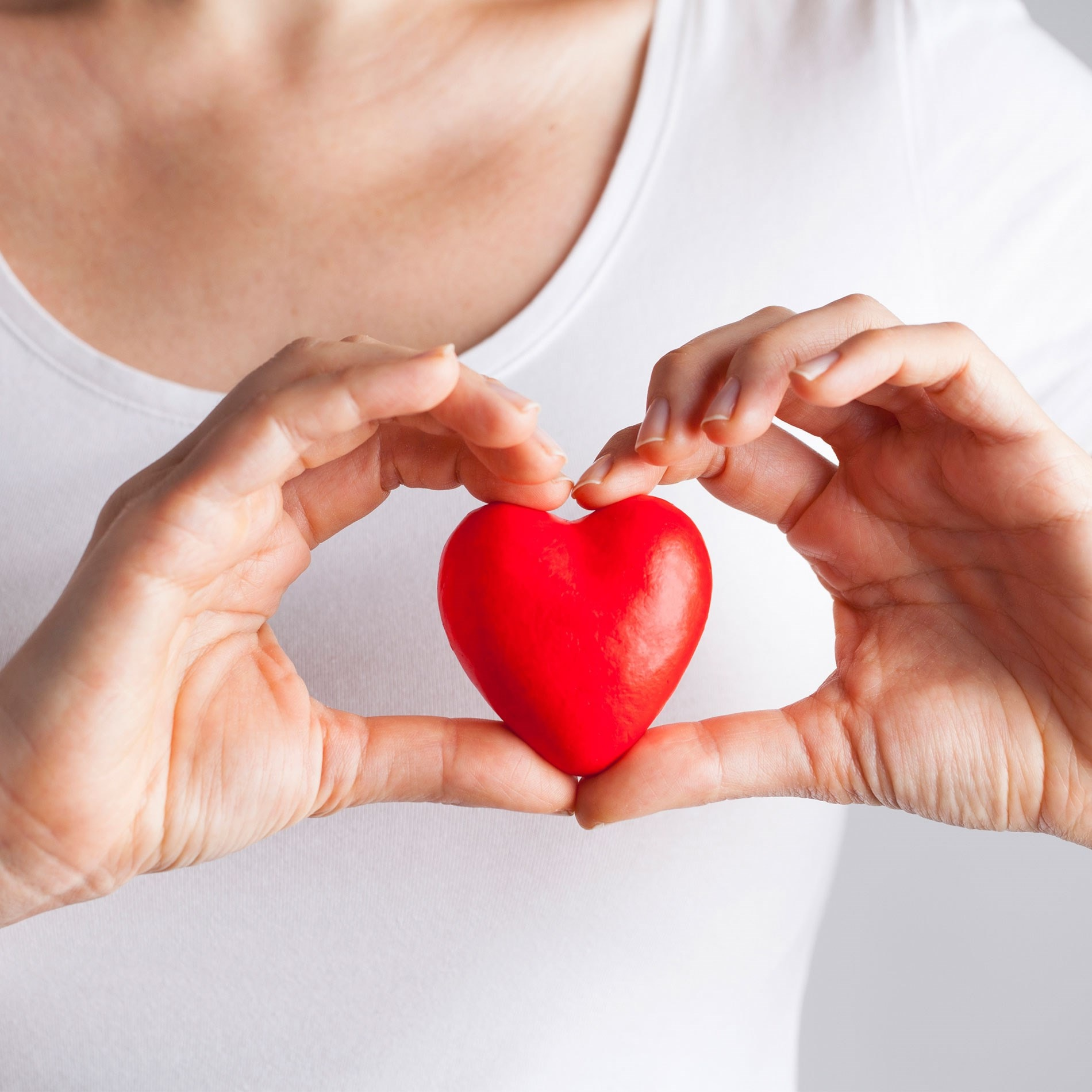 woman holding a heart shape