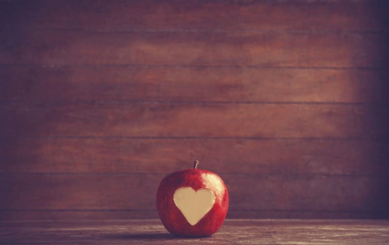Apple with heart-shaped bite