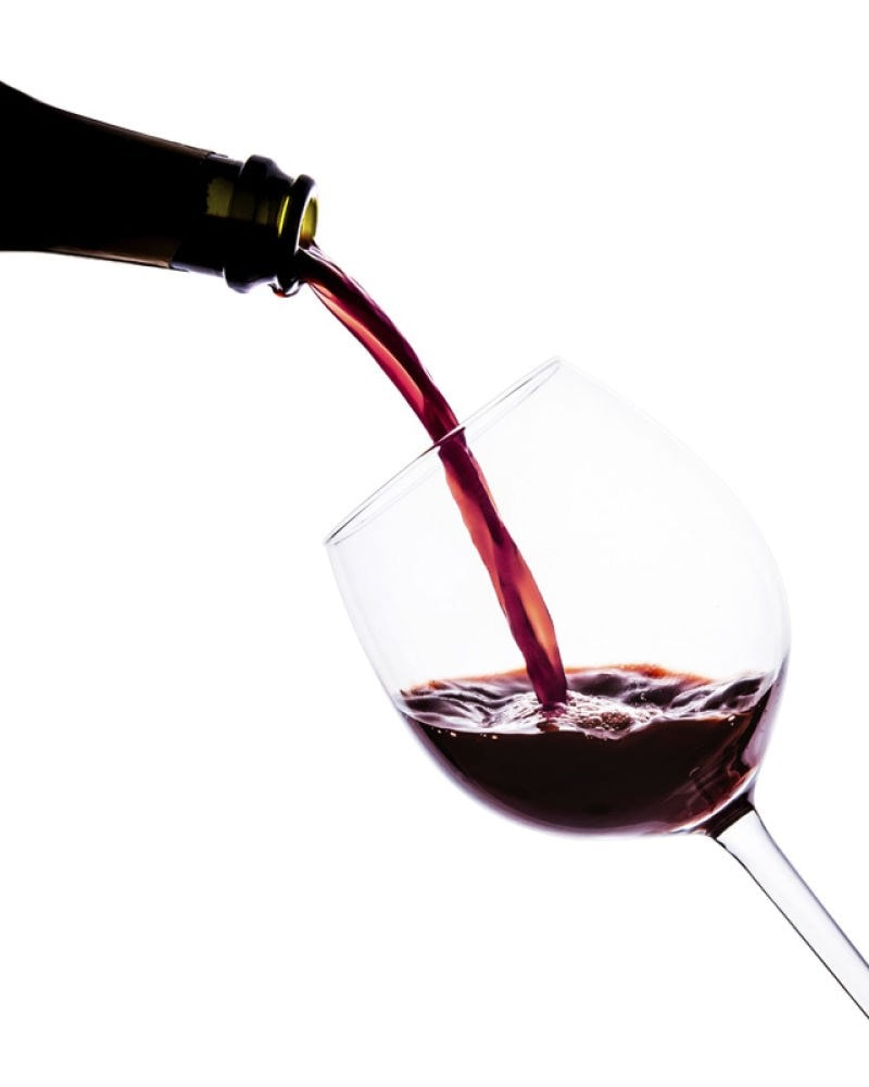 glass of wine being poured