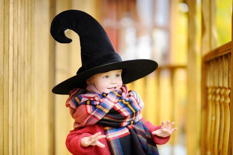 child wearing wizard hat