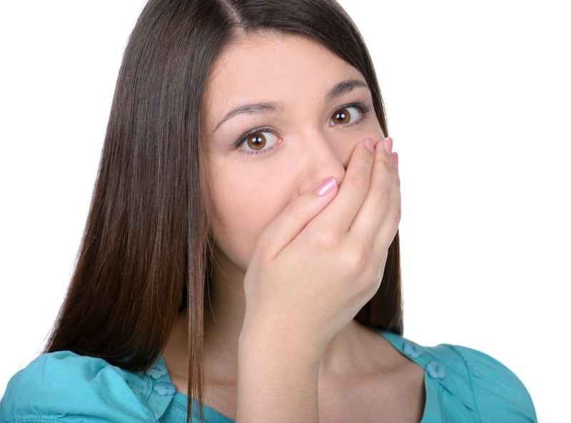 woman covering mouth and nose with hand