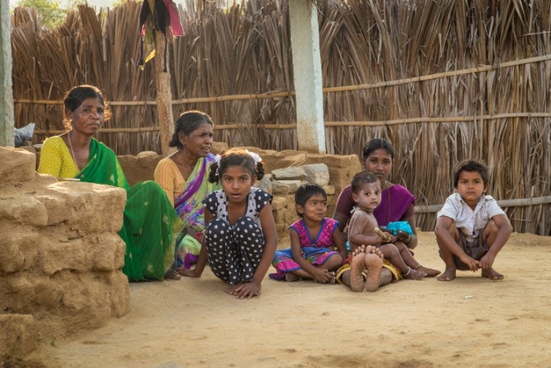Indian family sitting on ground