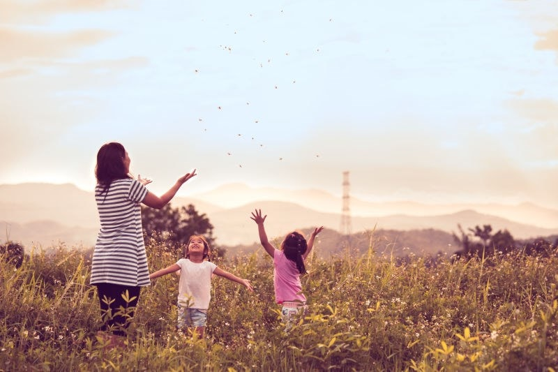 mother daughters playing in field