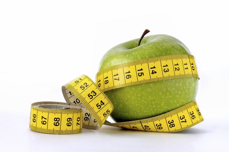 tape measure and apple