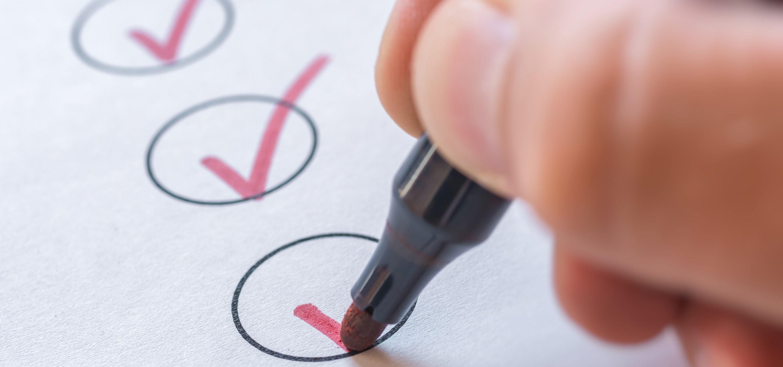 ticking a checklist.