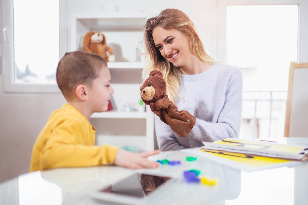autistic child playing with an adult