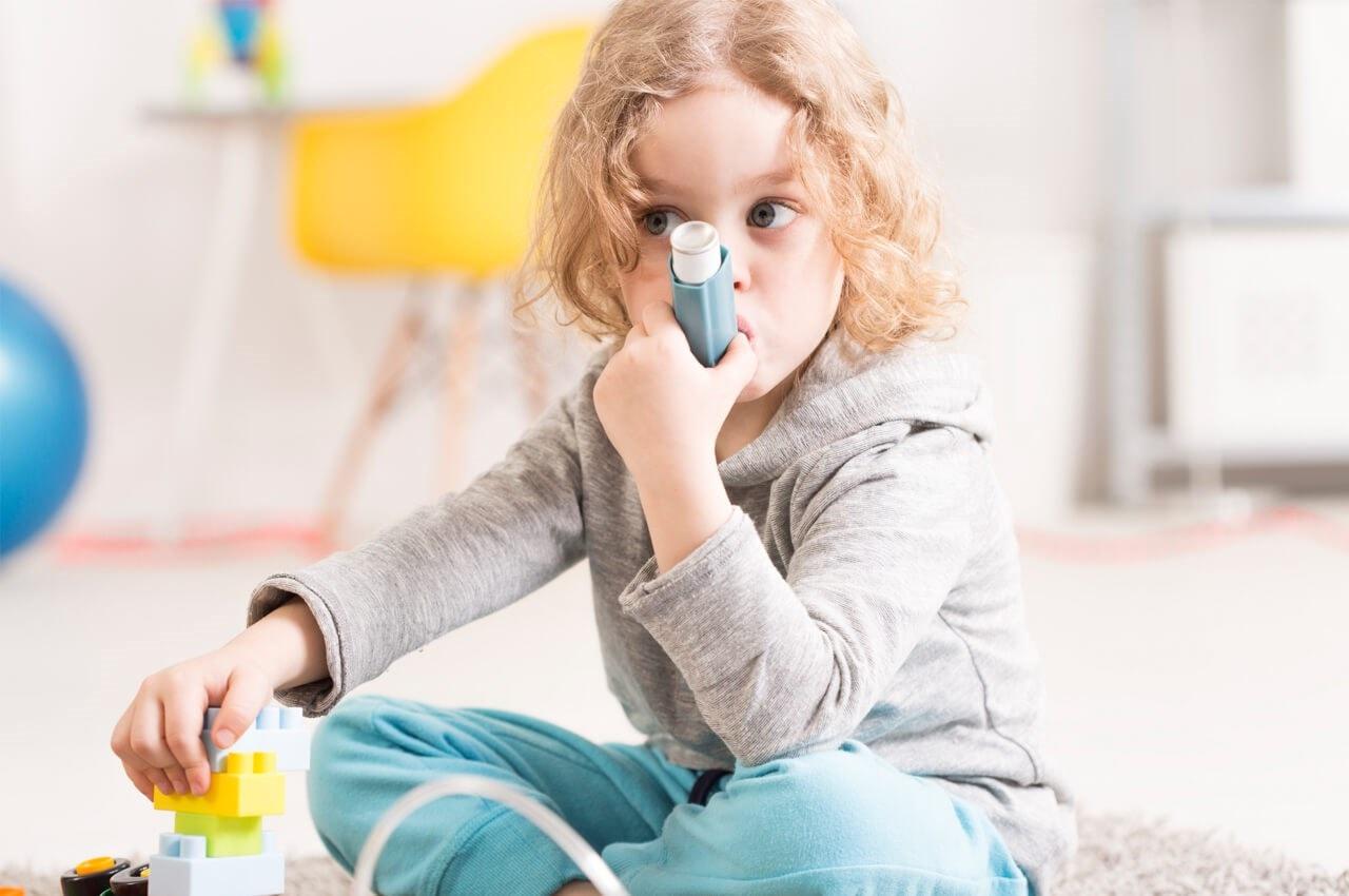 child taking their inhaler